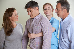 Woman Demonstrating Heimlich Maneuver In First Aid Class Stock Photography
