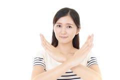 Woman demonstrating prohibiting gesture Stock Photo