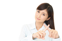Woman demonstrating prohibiting gesture Stock Images