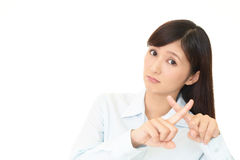 Woman demonstrating prohibiting gesture Royalty Free Stock Images