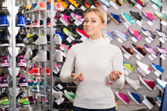 Woman demonstrating shoes in shop Royalty Free Stock Photos