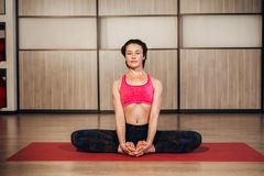 Woman demonstrating Sukhasana or Easy yoga pose Stock Photography
