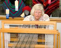 Woman Demonstrating Weaving on Loom. LYNDEN, WA - August 19, 2009 - Jane Doe is demonstrating at a live event at Lynden Fair recently the use of a textile loom Stock Image