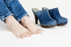 Woman and denim clogs Royalty Free Stock Image