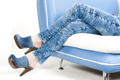 Woman and denim clogs Royalty Free Stock Photo