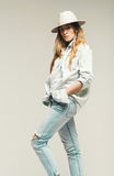 Woman in denim clothes and hat royalty free stock images