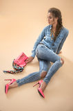 Woman in denim costume Royalty Free Stock Photography