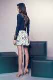 Woman in denim jacket and skirt Stock Photo
