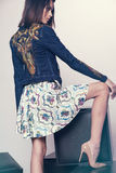 Woman in denim jacket and skirt Stock Photography