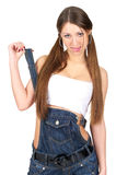 Woman in denim overalls Stock Image