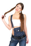 Woman in denim overalls. Sensual woman in denim overalls over white background Stock Photos