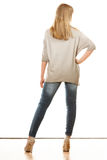 Woman in denim pants high heels shoes back view Royalty Free Stock Images