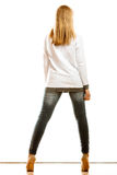 Woman in denim pants high heels shoes back view Stock Photo