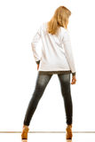 Woman in denim pants high heels shoes back view Royalty Free Stock Photography
