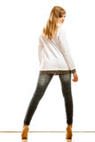 Woman in denim pants high heels shoes back view Stock Photography