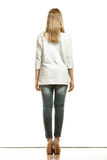Woman in denim pants white blank top back view Stock Images
