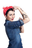 Woman in denim shirt. With red kerchief holding one hand in air Royalty Free Stock Image