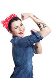Woman in denim shirt. With red kerchief holding one hand in air Stock Images