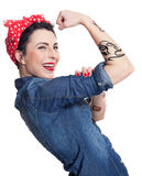 Woman in denim shirt. With red kerchief holding one hand in air Royalty Free Stock Images