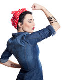 Woman in denim shirt. With red kerchief holding one hand in air Royalty Free Stock Photo