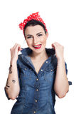 Woman in denim shirt. With red kerchief showing tongue while smiling Stock Images
