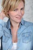 Woman in a denim shirt. Closeup of woman in a denim shirt royalty free stock photography