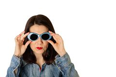 Woman in denim shirt and blue sunglasses with red lipstick and n. Ail polish. Isolated background Stock Photo