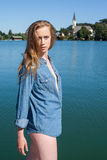 Woman in Denim Shirt Standing by Quiet Lake Royalty Free Stock Image