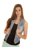 Woman in denim vest serious Stock Photo