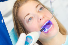 Woman at dental appointment. Woman at a dental appointment royalty free stock photos