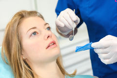 Woman at dental appointment stock image