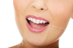 Woman with dental floss. Royalty Free Stock Photos