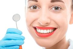 Woman with dental mirror on white background Royalty Free Stock Photo