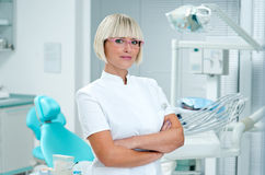 Woman dentist. Standing in her office Royalty Free Stock Photos