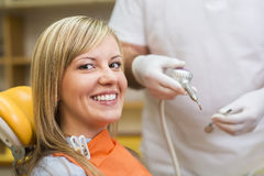Woman at the dentist Stock Photography