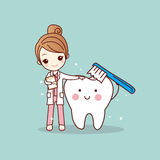 Woman dentist brush clean teeth Stock Photography