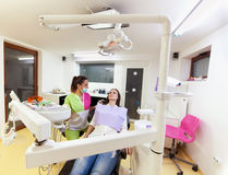 Woman dentist checking up her patient Royalty Free Stock Image