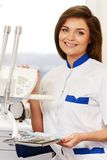 Woman dentist with dental tools Royalty Free Stock Image