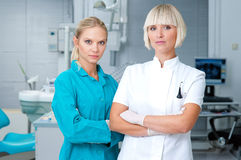 Woman dentist with her assistant Stock Image