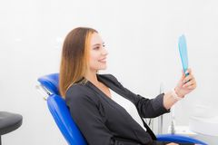 Woman at the dentist with a mirror