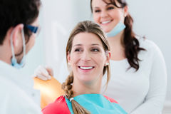 Woman with dentist and nurse smiling Stock Photography
