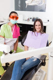 Woman dentist and patient in a dental clinic Stock Image