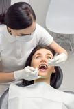 Woman in the dentist's chair is looking frightened. Top view of a women in the dentist's chair is looking frightened Royalty Free Stock Image