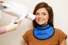 Woman at dentist's surgery Stock Image