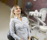 Woman at the dentist. Woman sitting in the chair at the dentist office Royalty Free Stock Images