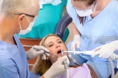 Woman at dentist surgery have treatment Stock Photos