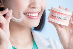 Woman dentist take brace Royalty Free Stock Photography