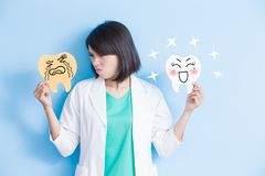 Woman dentist take tooth board Royalty Free Stock Image