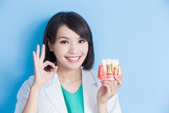 Woman dentist take implant tooth Royalty Free Stock Photography