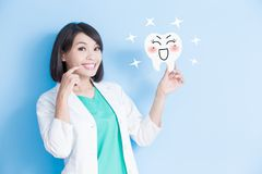 Woman dentist take tooth board Stock Images